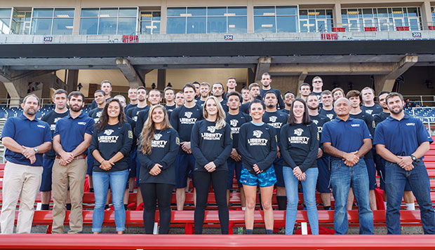 In early September, coaches, assistant staff, and the 32 members of Liberty's wrestling team posed for a group photograph in Williams Stadium, where the wrestlers did the bulk of their workouts during the weekend's 24-hour challenge. test test test test