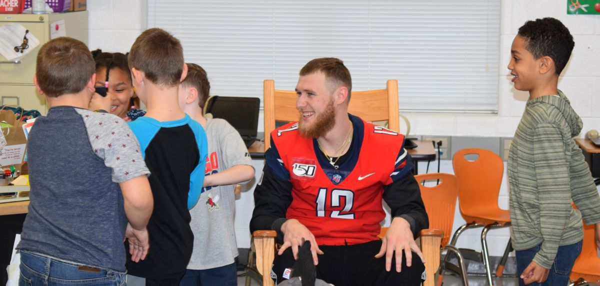 Liberty Flames student-athletes participated in the Third Annual Hop on Pop Reading Day at Yellow Branch Elementary School in Rustburg in March.