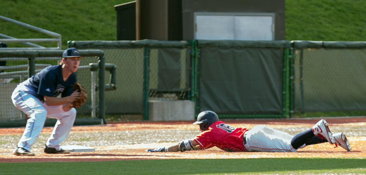 Cam Locklear slides safely into third for a triple in the third inning, Saturday.