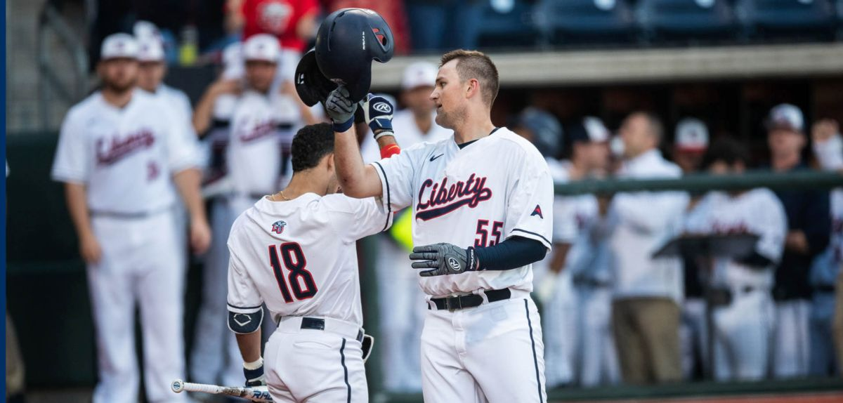 Logan Mathieu greeted at home plate by Cam Locklear after hitting his second home run of the season.