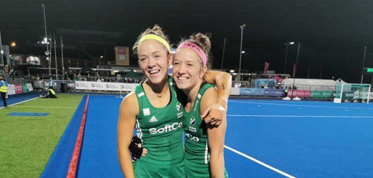Serena Barr (left) and her twin sister Bethany (right) play on Ireland's Olympic-qualifying national field hockey team.
