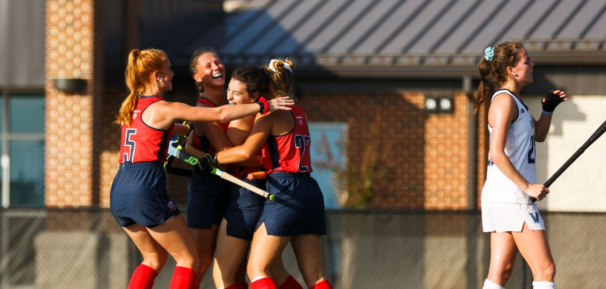 Baffone (second Liberty player from right) scored her first career goal in Liberty's milestone 100th win in program history.