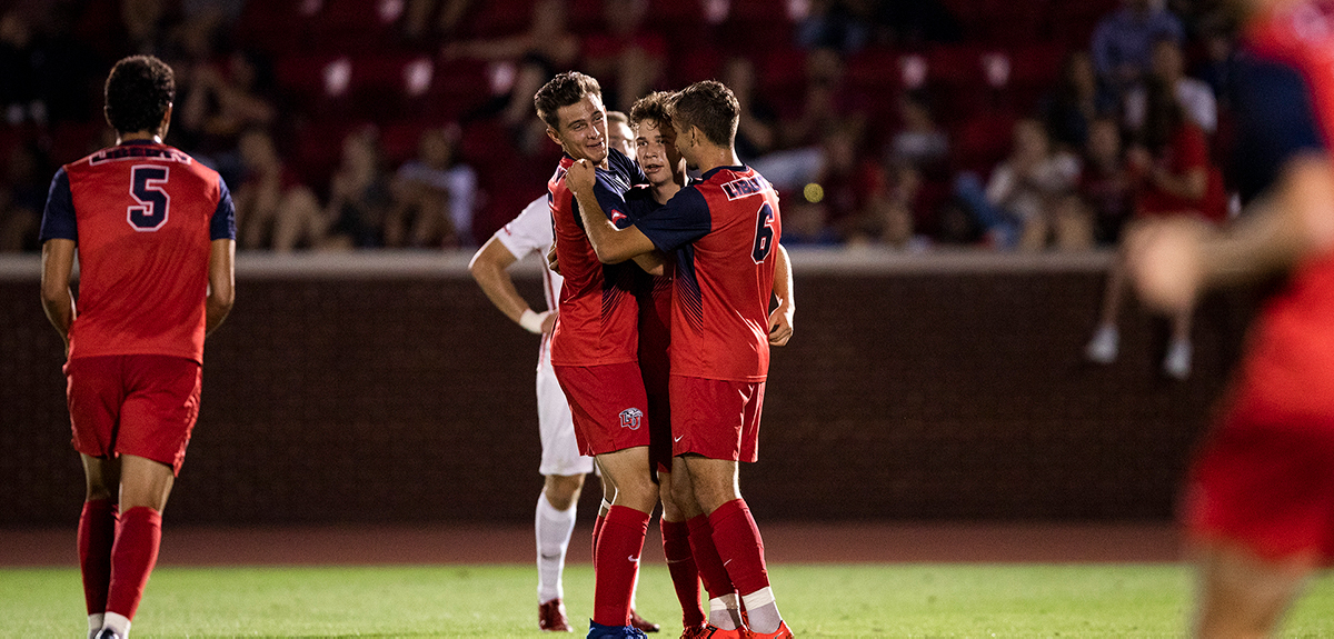Flames celebrate goal by Seth Clark in win over Duquesne, last season.