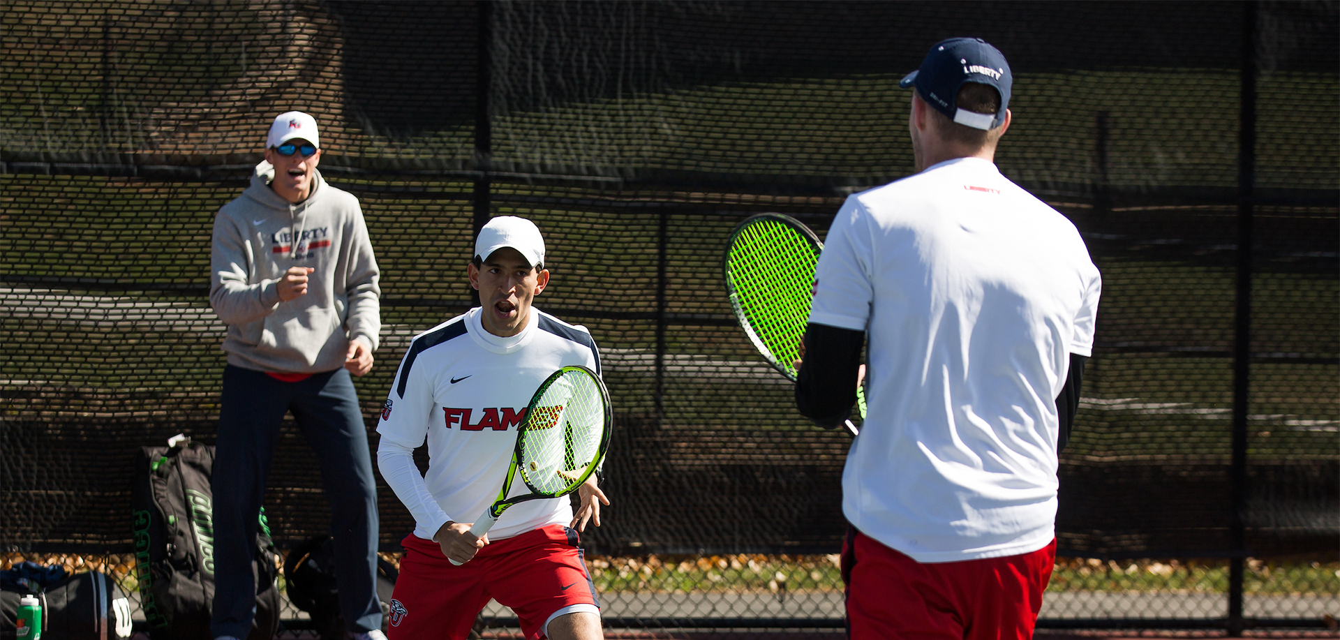 Castano (front right) and Poynter (back left) have been Liberty's most successful doubles unit during the 2016-17 season.