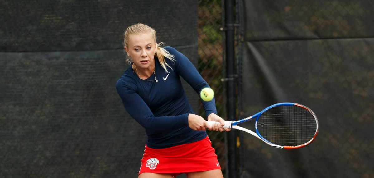 Almborg won in doubles and singles on Sunday at the Liberty Invite.