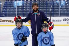 For Flames hockey player, working with young campers brings back memories