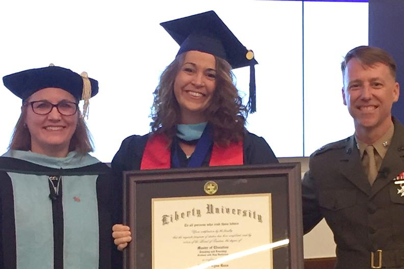 graduate receives diploma during surprise ceremony at